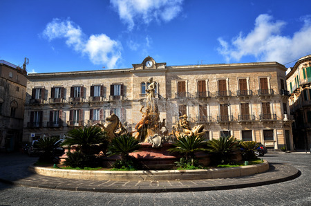 ortigia: Fountain of Diana in the old downtown of Syracuse, Sicily, on Ortigia island Stock Photo