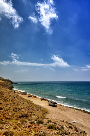Holiday at the sea in a caravan, free camping on the beach with a motorhome Stock Photo