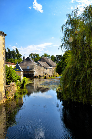 castel: Verteuil-sur-Charente is a village situated on the banks of the river Charente, in the quiet French countryside with a beautiful castel and water mills Stock Photo