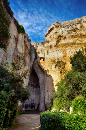 The entrance to the cavern known as the Orecchio di Dionisio (Ear of Dionysius) in the Archaeological Park in Syracuse, Sicily, Italy Stock Photo