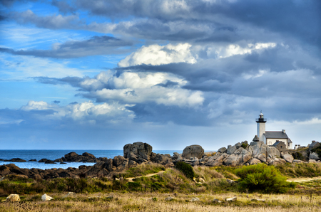 Phare de Pontusval, small lighthouse in the rocks on the beach at Brignogan-Plage, Brittany, France Stock Photo