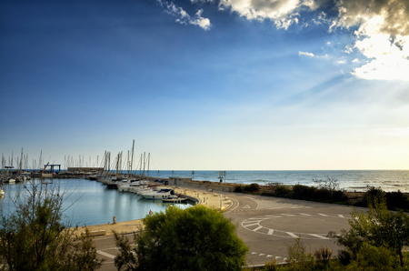 Marina di Ragusa Harbour is modern touristic port located in Sicily, in the most southern part of Italy, in a strategic position in the middle of the Mediterrean Sea.