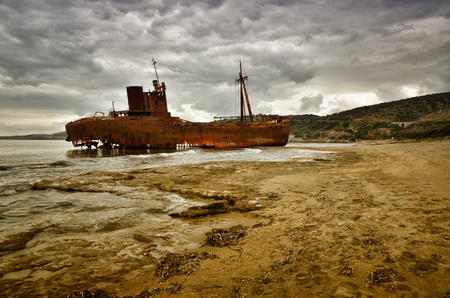 Old ship wrecked on the Greek coast and abandoned on the beach, his name was Dimitrios. Photo representing the concept of abandoned and failure