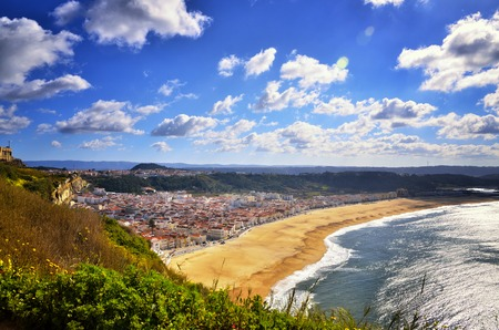 Nazare is one of the most popular seaside resorts in Portugal, considered by some to be among the best beaches in Portugal. The neighbourhoods are linked by a funicular railway. Stock fotó