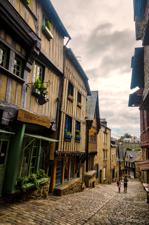 Dinan is one of the most attractive and best preserved small towns in Brittany, France, with ramparts, half-timbered houses, port and cobbled streets filled with art galleries and craft shops