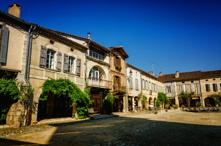 Labastide dArmagnac is one of the most beautiful bastides in southwestern France. The village was founded in 1291 and the square is still surrounded by the same arcades with covered passages.