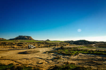 Land Rover Defender at Bardenas Reales, Spain a semi-desert landscape in which erosion has carved whimsical shapes to create almost lunar effects with badlands and lonely hills Editorial