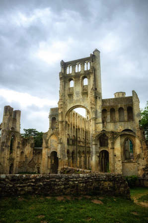 Jumieges Abbey was a Benedictine monastery situated in Normandy, France. The ruins of the Abbey impress by their scale, and by their setting, in a beautiful meander in the Seine river 写真素材