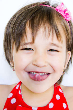 Little girl is showing a tongue photo