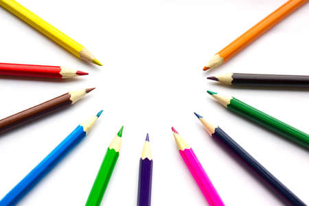 colored pencils on a white background photo