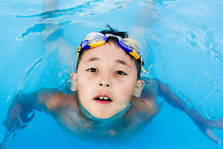 a little boy swimming in the water photo
