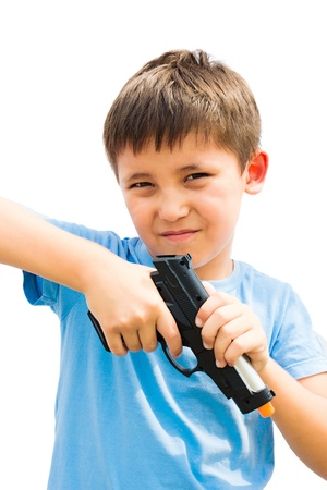 a little boy playing with toy gun photo