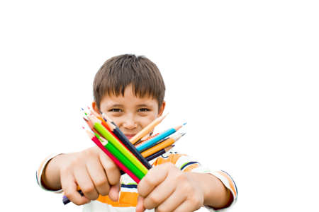 boy with colored pencils in their hands photo