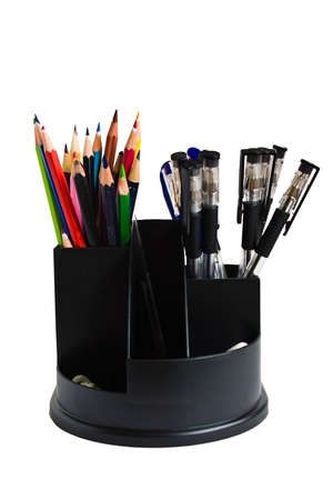 colored pencils and pens in a holder on a white background