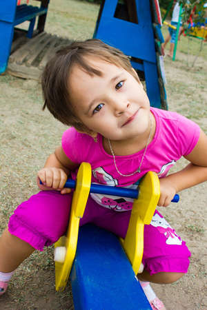 happy, little girl playing on the playground,in kindergarten Stock Photo