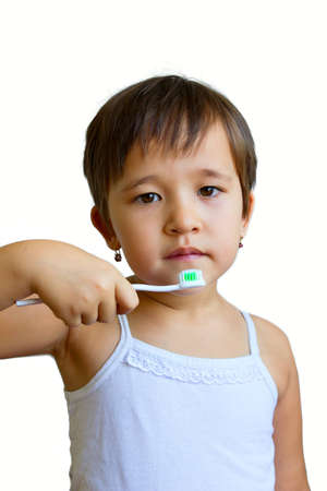 little girl holding a toothbrush, isolate on a white background