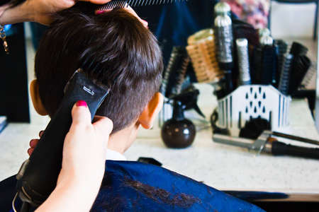 hairdressers cuts boy Stock Photo