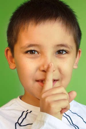 the little boy asks to keep silence and secret Stock Photo