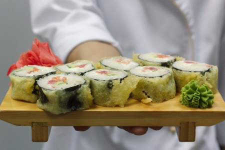 chef holding hot rolls Stock Photo