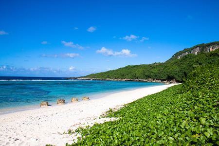 A secluded sandy beach on the island of Saipan. Stock fotó