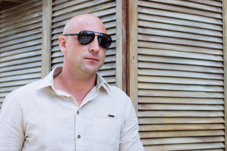 bald man at wood background at spring time. shirt. summer