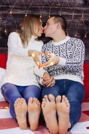 new year light heart at couple hands. feet Standard-Bild