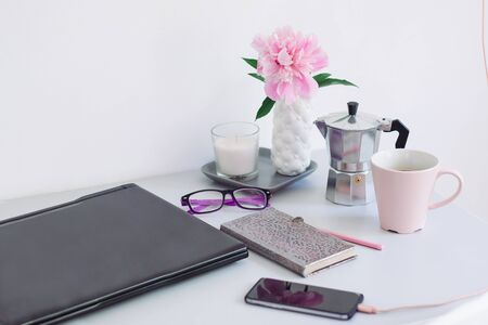 Dorm room, table with stationery and laptop. back to school, ready for studying. Stock Photo