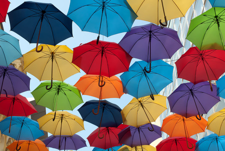 Lots of colorful umbrellas opposite opposite sky in the city of Belgrade,Serbia photo