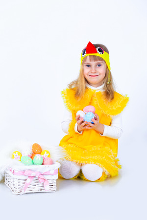 Girl with easter eggs on white  photo