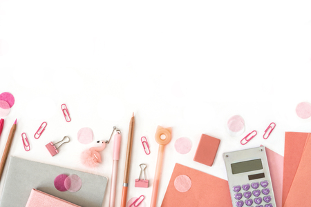 Stationery composition . Back to school. Paper sheets notepad pencils pen eraser clips calculator confetti . Flat lay