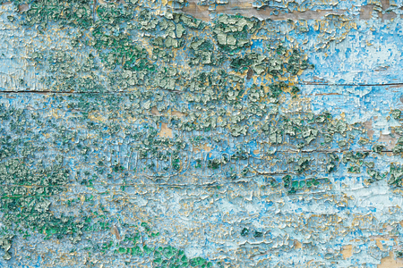Crackled paint on wooden surface Abstract background