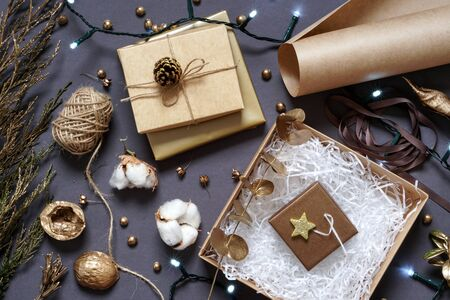 Gift boxes, natural packaging materials, craft paper, twine, ribbon , coniferous branch, Christmas and New year decor Photo