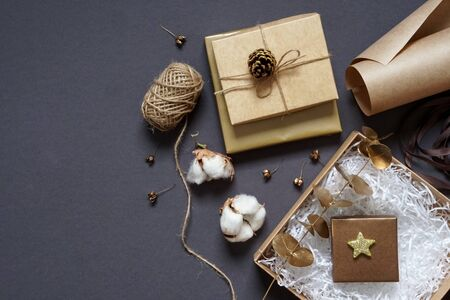 Gift boxes, natural packaging materials, craft paper Christmas and New year decor Photo