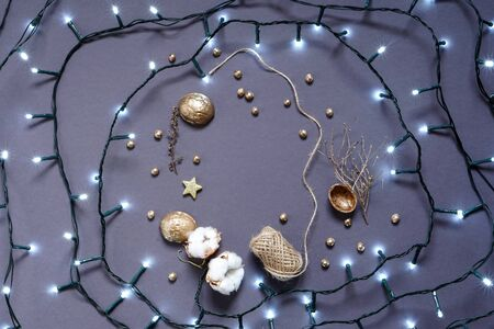 Natural decoration materials and led garland. Christmas and New year decor. Photo