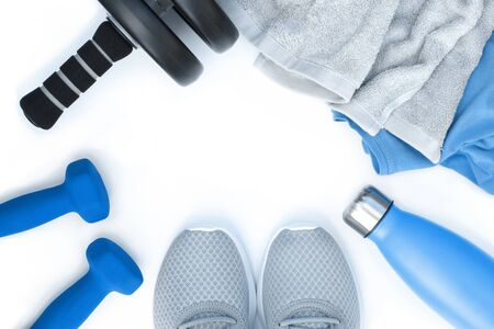 Sport equipment in blue grey style . Running shoes dumbbells water bottle towel t shirt. Flat lay composition