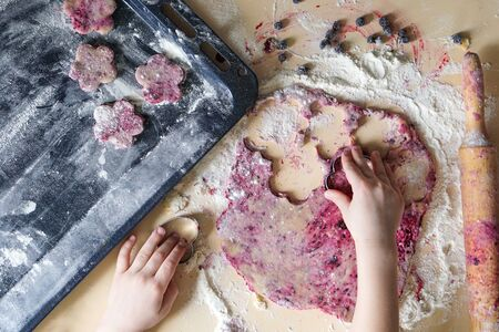 Baking cookies. Food receipts, natural ingredients. Homemade bakery, culinary. Child hands. Flat lay photo composition