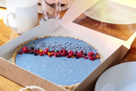 Beautiful cake decorated with freeze-dried berries. Preparation to home tee party. Photo