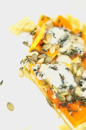 Slice of homemade cake with pumpkin, cheese, seeds and thyme. Home receipts photo Imagens