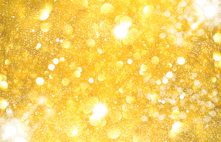 glimmering: Yellow golden glittering Christmas lights. Blurred abstract background Stock Photo