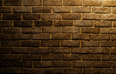 basement: dark red brick wall background in basement with beams of spot lights