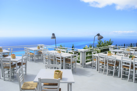 bawl: Luxury terrace balcony of exclusive seaside resort with fancy table and chairs fuit and flower bawl and full sea panorama in the beautiful morning lights