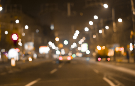 defocused colorful car lights and street lamp bokeh abstract background, blurred city life at night  Stok Fotoğraf