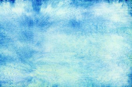 Blue empty school chalkboard textured background.