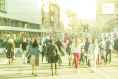 unrecognizable Pedestrians in modern city street, blur abstract people background