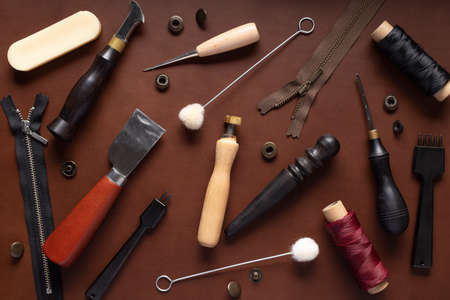 set of tools for sewing purses, handbags, clutches, belts made of leather. 写真素材