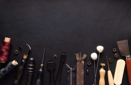 border of various tools for sewing leather goods. Handmade wallets, belts, bags. 写真素材