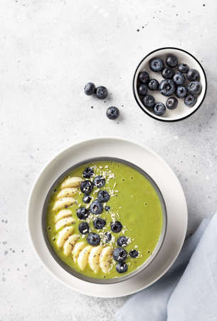 smoothie bowl with green matcha, banana, almond milk, blueberries