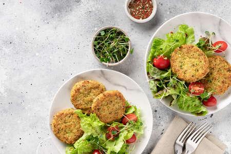 Green broccoli and quinoa burgers in plates