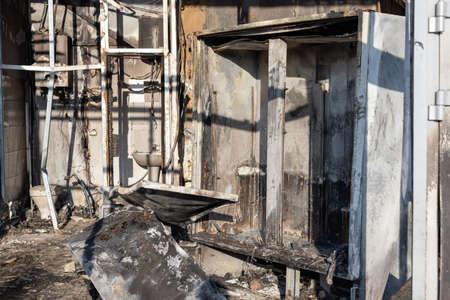 burnt refrigerator in supermarket after intense fire burning. investigation for insurance. selective focus.