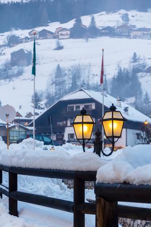 fassa: Winter evening in a small town in the mountains.Campitello, Val di Fassa, Italy.